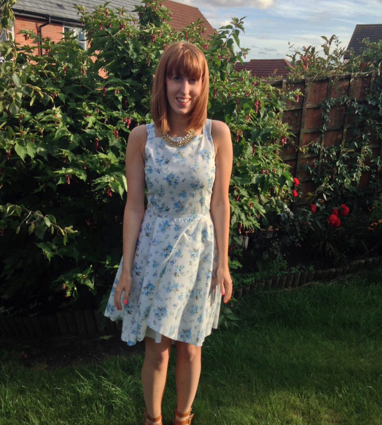 A girly swirly wedding guest dress